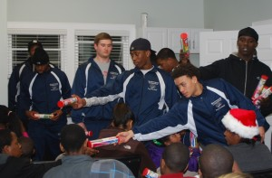 Players from the CT Grizzlies hand out toothbrushes donated by Stamford Hospital to local children