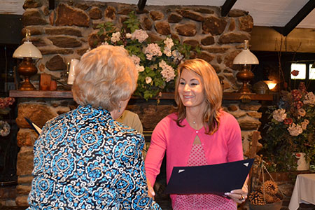 State Rep. Themis Klarides (R-Derby) presents Joan McTaggart Kayser with a legislative citation in honor of her contributions to the Valley community.